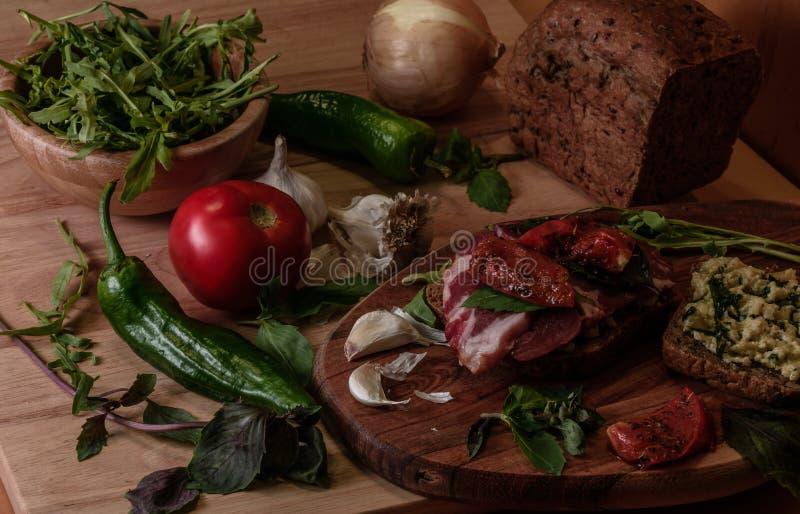 Sandwich with pesto, sun-dried tomato, basil, arugula and smoked beef stock photos