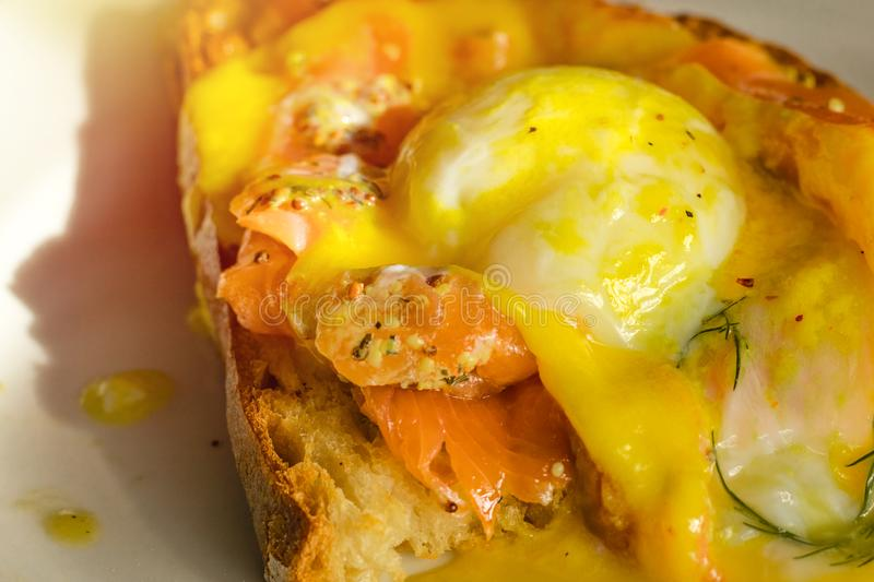 Sandwich with poached egg, with smocked salmon stock images