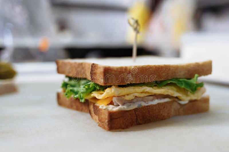 Sandwich in the cooking process on a whiteboard stock photo
