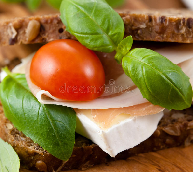 Sandwich with prosciutto and brie royalty free stock photos