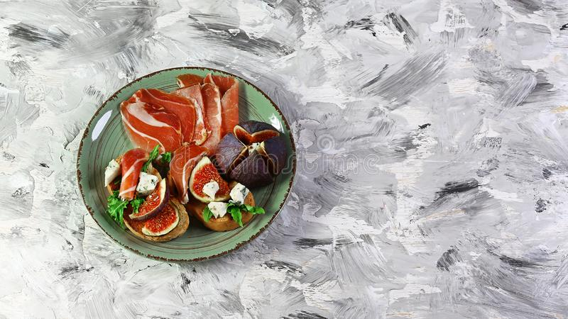 Sandwich with prosciutto, dorblyu cheese and fig. Seasonal harvest crop local produce concept. Flat lay. Top view stock images