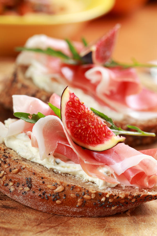 Sandwich with prosciutto and goat cheese stock photos