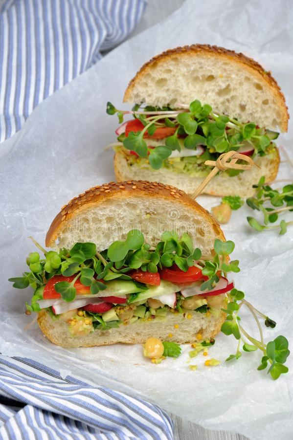 Sandwich with radish sprouts and vegetables royalty free stock photos