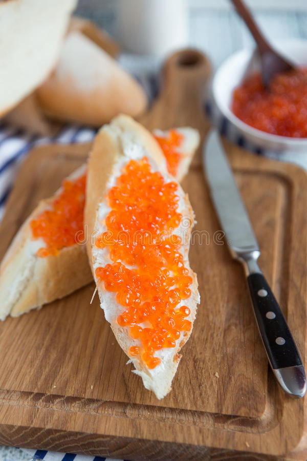 Sandwich with red caviar. Food breakfast baked royalty free stock photos