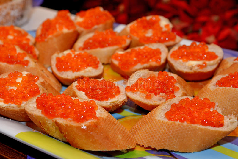 Sandwich with red caviar salmon and butter royalty free stock images