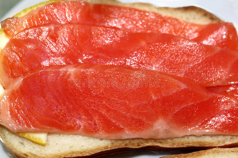 Sandwich with red fish trout royalty free stock photo