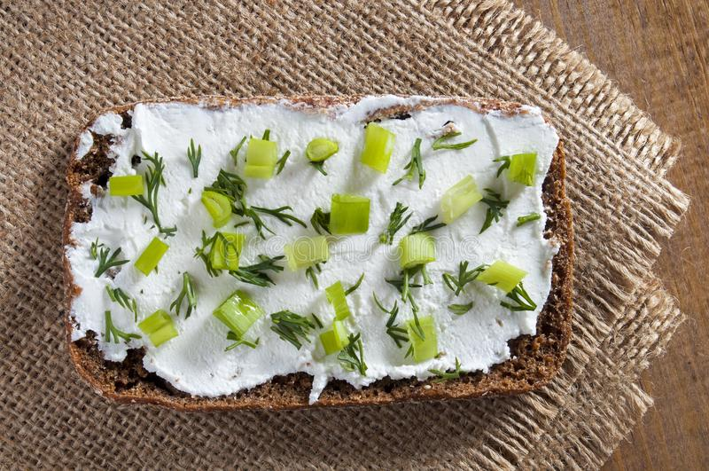Sandwich of rye bread and curd cheese, dill and chives. View from above royalty free stock photos