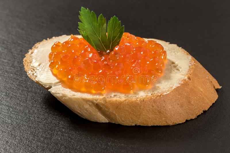 Sandwich with salmon red caviar stock images