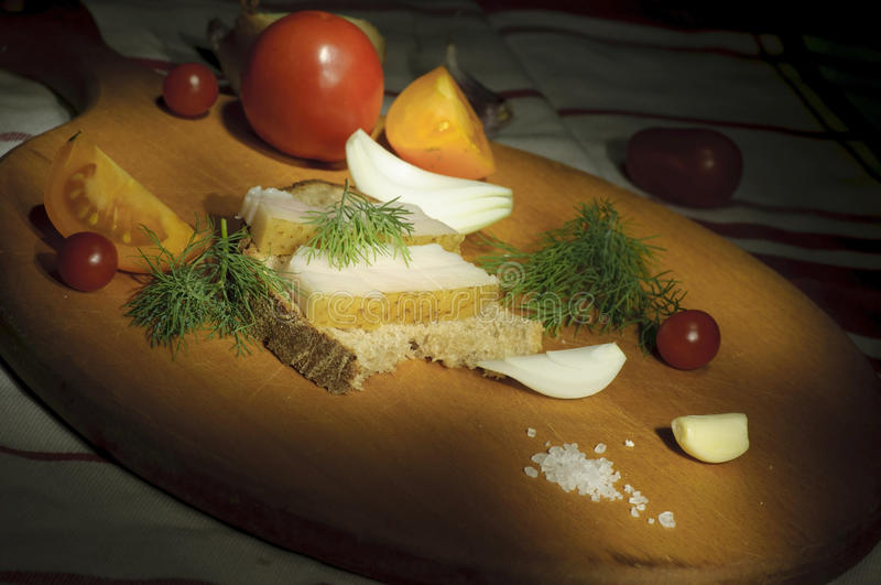Sandwich with salted lard, onion and tomatoes royalty free stock photos