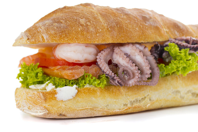 Sandwich with seafood and vegetables isolated stock photo
