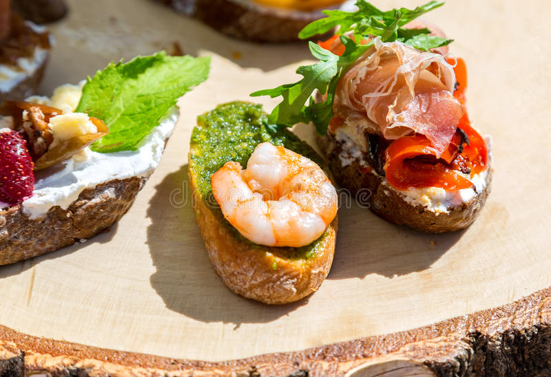 Sandwich with shrimps and fresh vegetables stock image