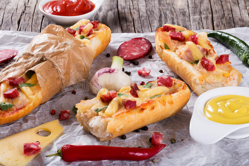 Sandwich with smoked sausage, corn and cheese stock photography
