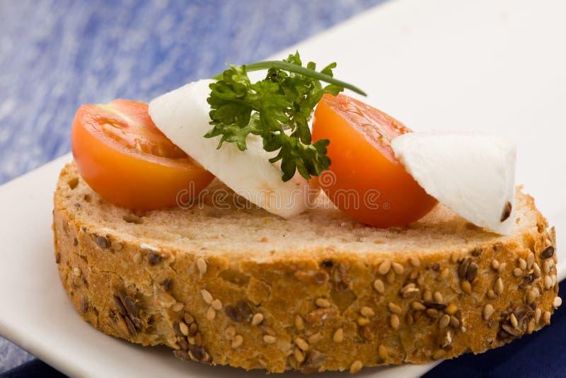 Download Sandwich With Tomatoe And Mozzarella Stock Photo - Image of bread, cereals: 18534272