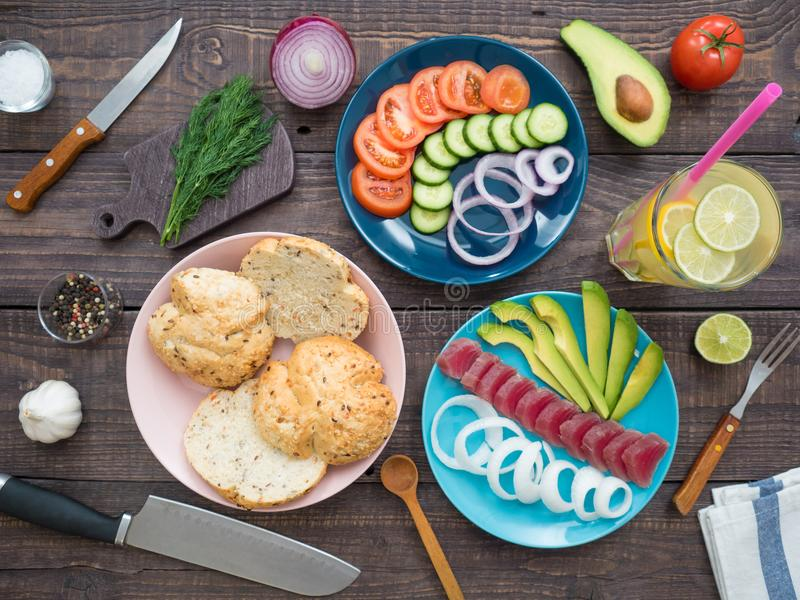 Sandwich with tuna on a plate, vegetables and a glass of lemonade stock image