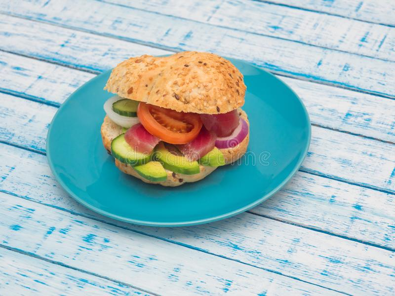 Sandwich with tuna and vegetables on a plate royalty free stock photography