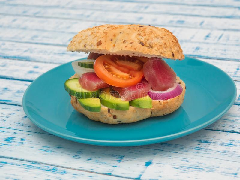 Sandwich with tuna and vegetables on a plate royalty free stock image
