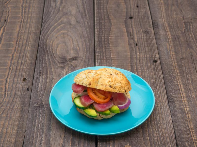 Sandwich with tuna and vegetables on a plate stock photos