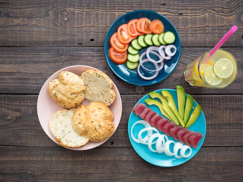 Sandwich with tuna on a plate, vegetables and a glass of lemonade stock photo