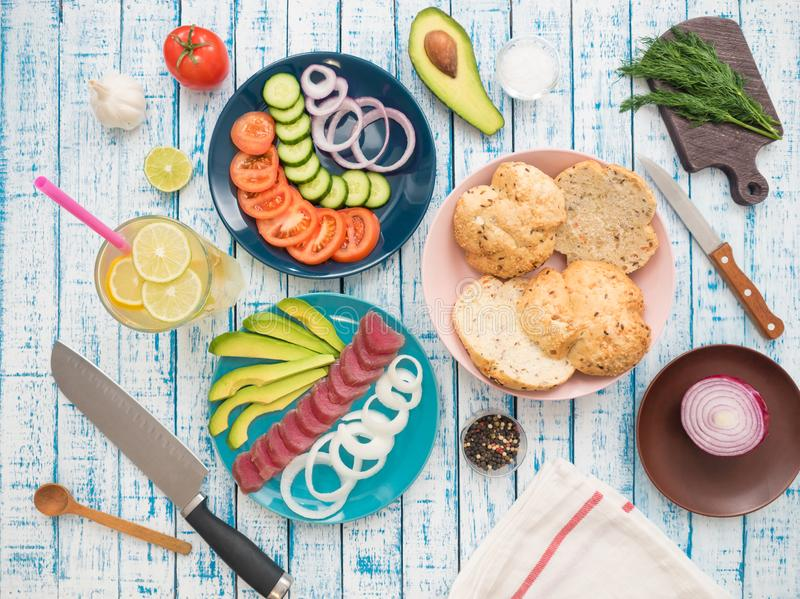 Sandwich with tuna on a plate, vegetables and a glass of lemonade royalty free stock images