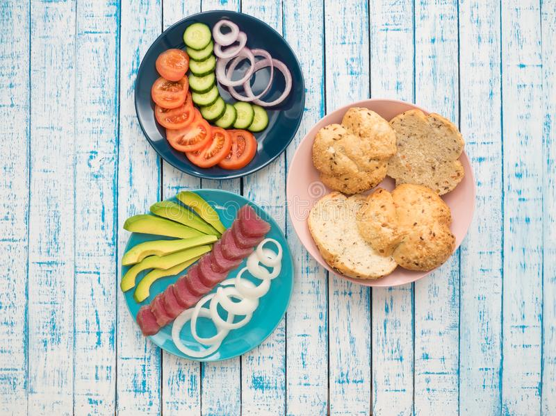 Sandwich with tuna and vegetables on a plate royalty free stock images