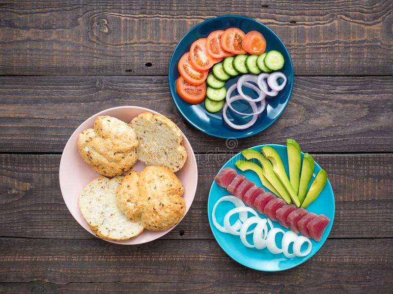 Sandwich with tuna and vegetables on a plate royalty free stock photos