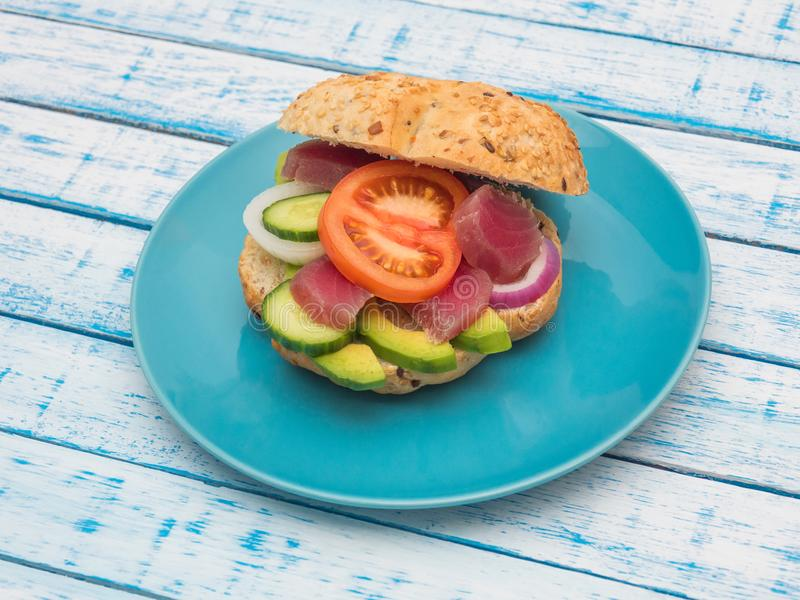 Sandwich with tuna and vegetables on a plate stock image