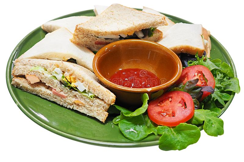 Sandwichbrood en ketchup, zijaanzicht op witte achtergrond wordt geïsoleerd die stock afbeelding