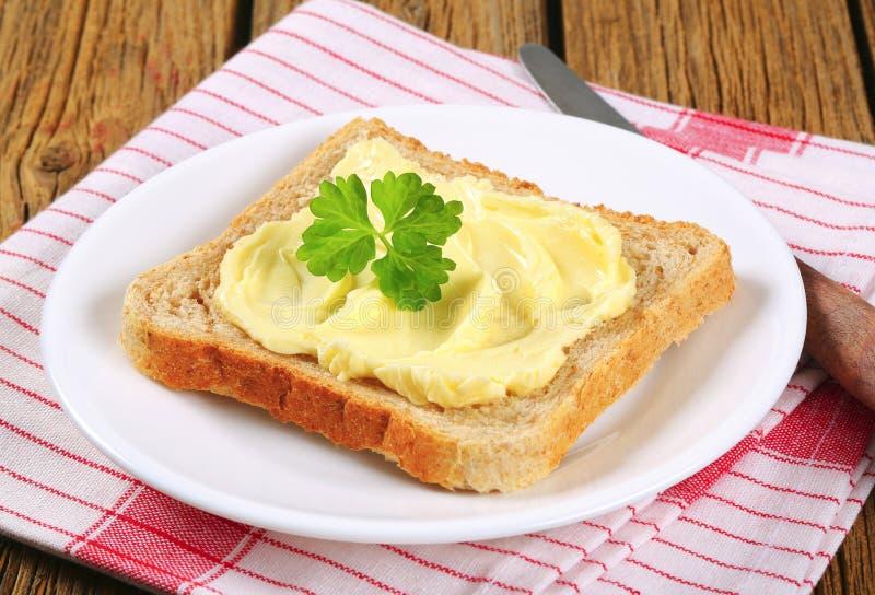 Sandwichbrood met boter stock afbeeldingen