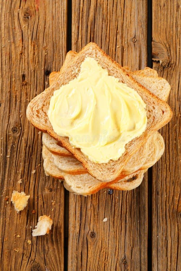 Sandwichbrood met boter stock afbeelding