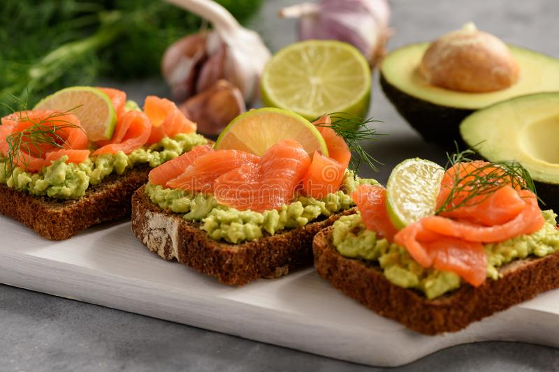 Sandwiches with avocado spread and smoked salmon. stock photography