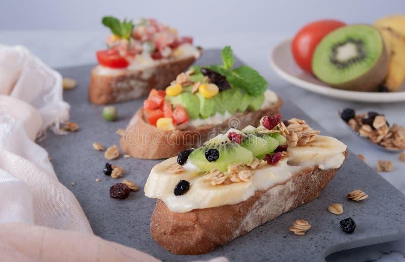 Sandwiches banana kiwi grains background stock image