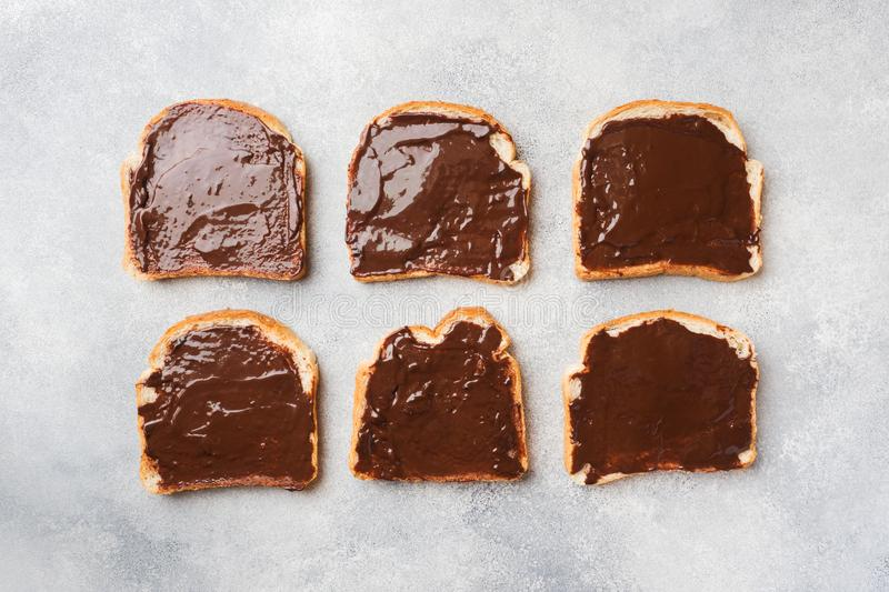 Sandwiches with chocolate paste on the gray table. Top view royalty free stock photo