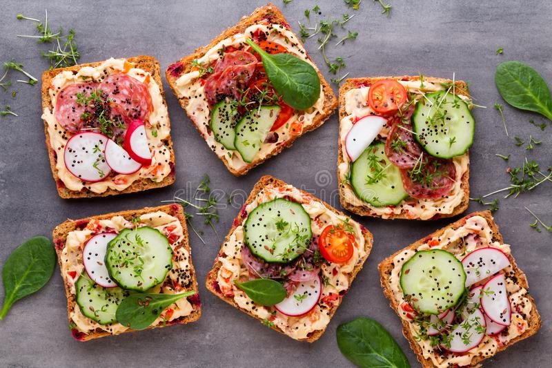 Sandwiches with cream cheese, vegetables and salami royalty free stock photo