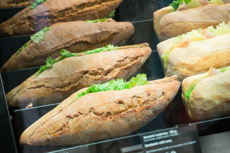 Sandwiches. Different sandwiches in window shop royalty free stock images