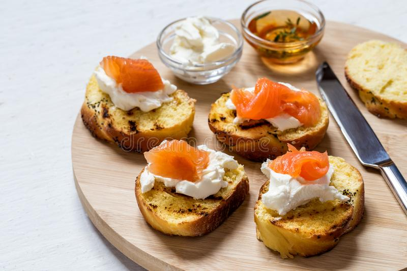 Sandwiches with fish salmon and cream cheese on a round Board royalty free stock images