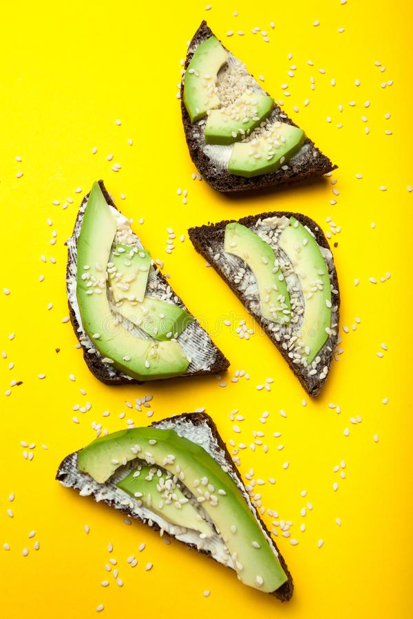 Sandwiches of fresh avocado and black bread, healthy organic food.  stock image
