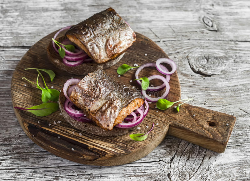 Sandwiches with grilled fish and quick pickled onions royalty free stock photography
