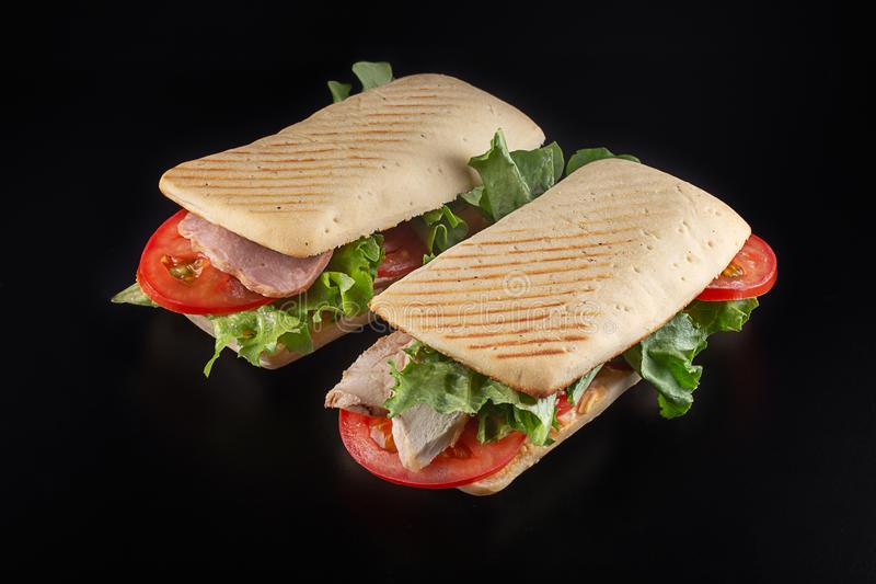 Sandwiches with ham, chicken and  vegetables royalty free stock photography