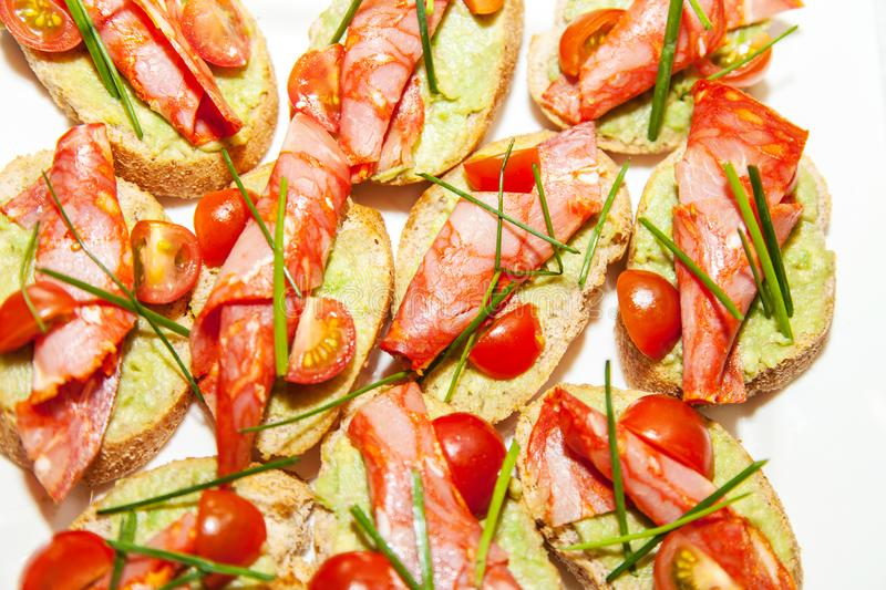 Sandwiches with ham and tomatoes royalty free stock image