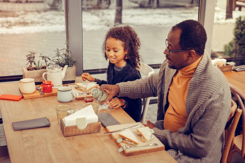 Father and daughter enjoying their weekend eating sandwiches royalty free stock images