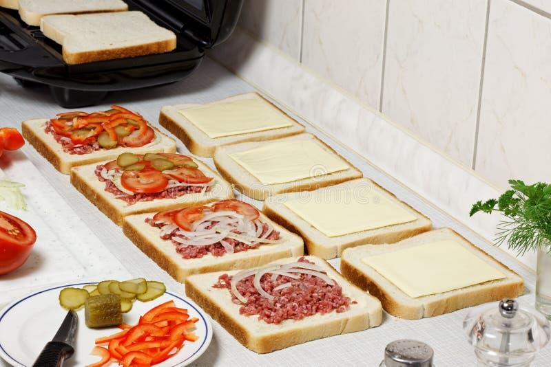 Sandwiches preparation. royalty free stock photos