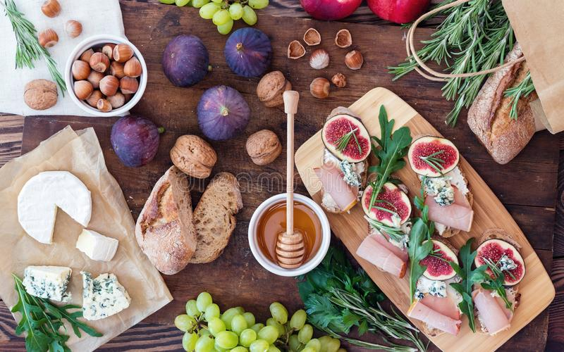 Sandwiches with ricotta, fresh figs, prosciutto, rosemary and bl royalty free stock photo