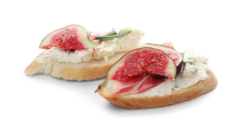 Sandwiches with ripe figs, prosciutto and cream cheese royalty free stock photography