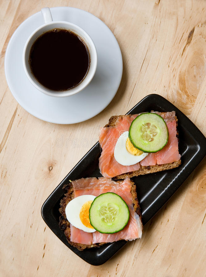Sandwiches With Rye Bread And Salmon And Coffee Stock Photos