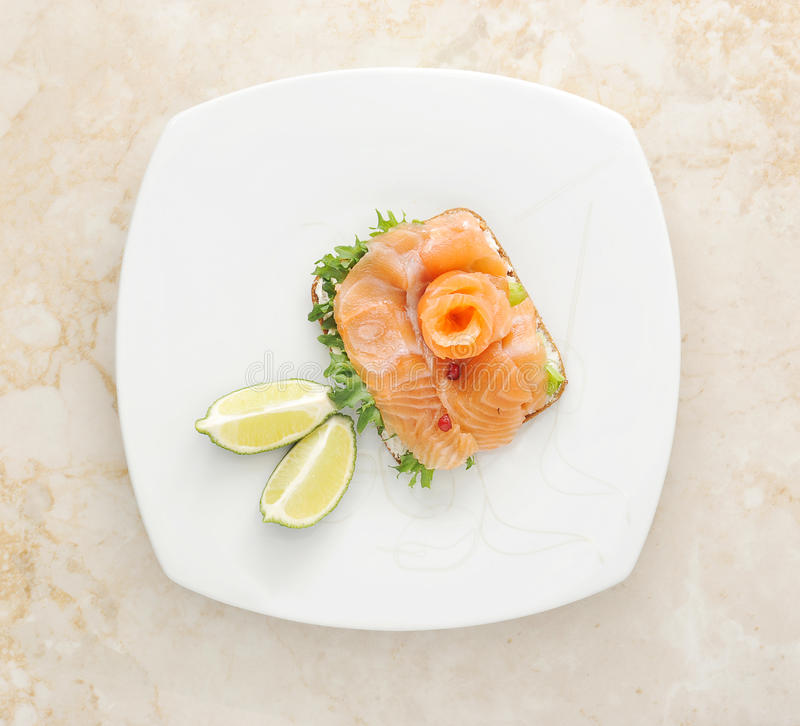Sandwiches of salmon with salad leaves royalty free stock photography