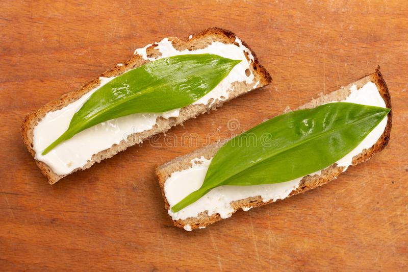 Sandwiches from slices of bread with mayonnaise and ramson leaves, top view. Close-up royalty free stock images