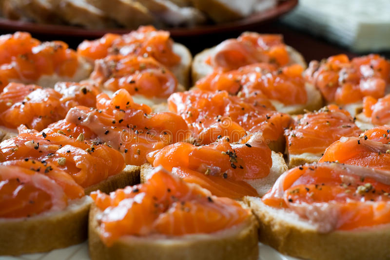 Sandwiches with smoked salmon royalty free stock photography