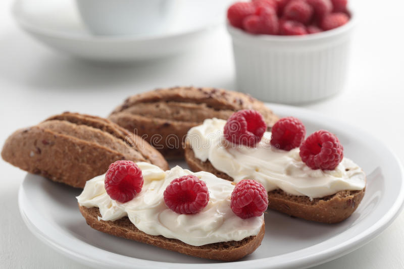Sandwiches with soft cheese and raspberry royalty free stock photo