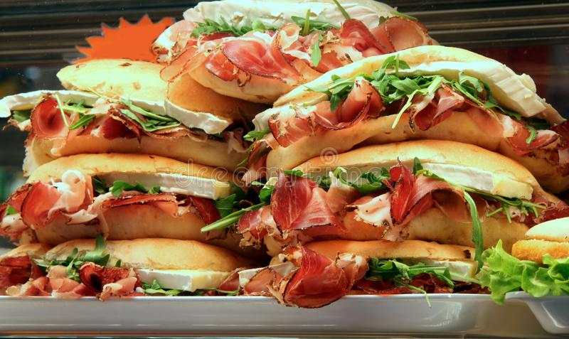 Sandwiches stuffed with ham and lettuce in a sandwich shop. Sandwiches stuffed with ham and lettuce for sale in a sandwich shop stock photos