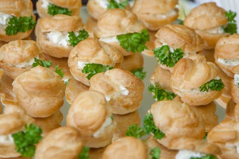 Buns, sandwiches, tartlets, small snacks closeup stock photography